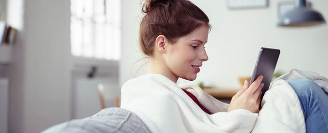 woman with a blanket in her home