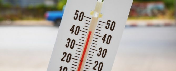 thermometer reading warm temperatures