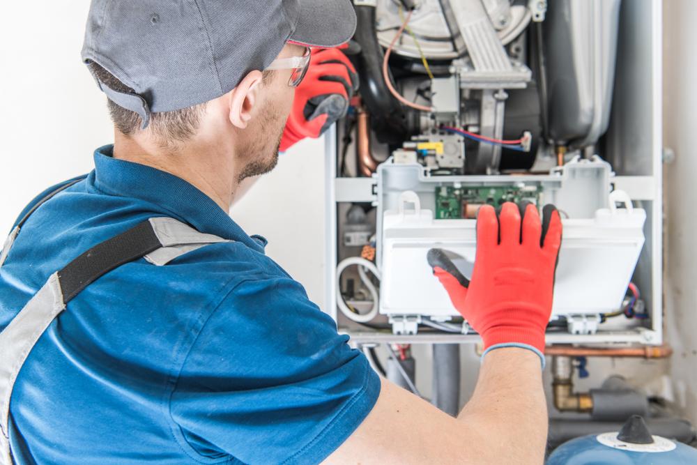 HVAC tech servicing a furnace